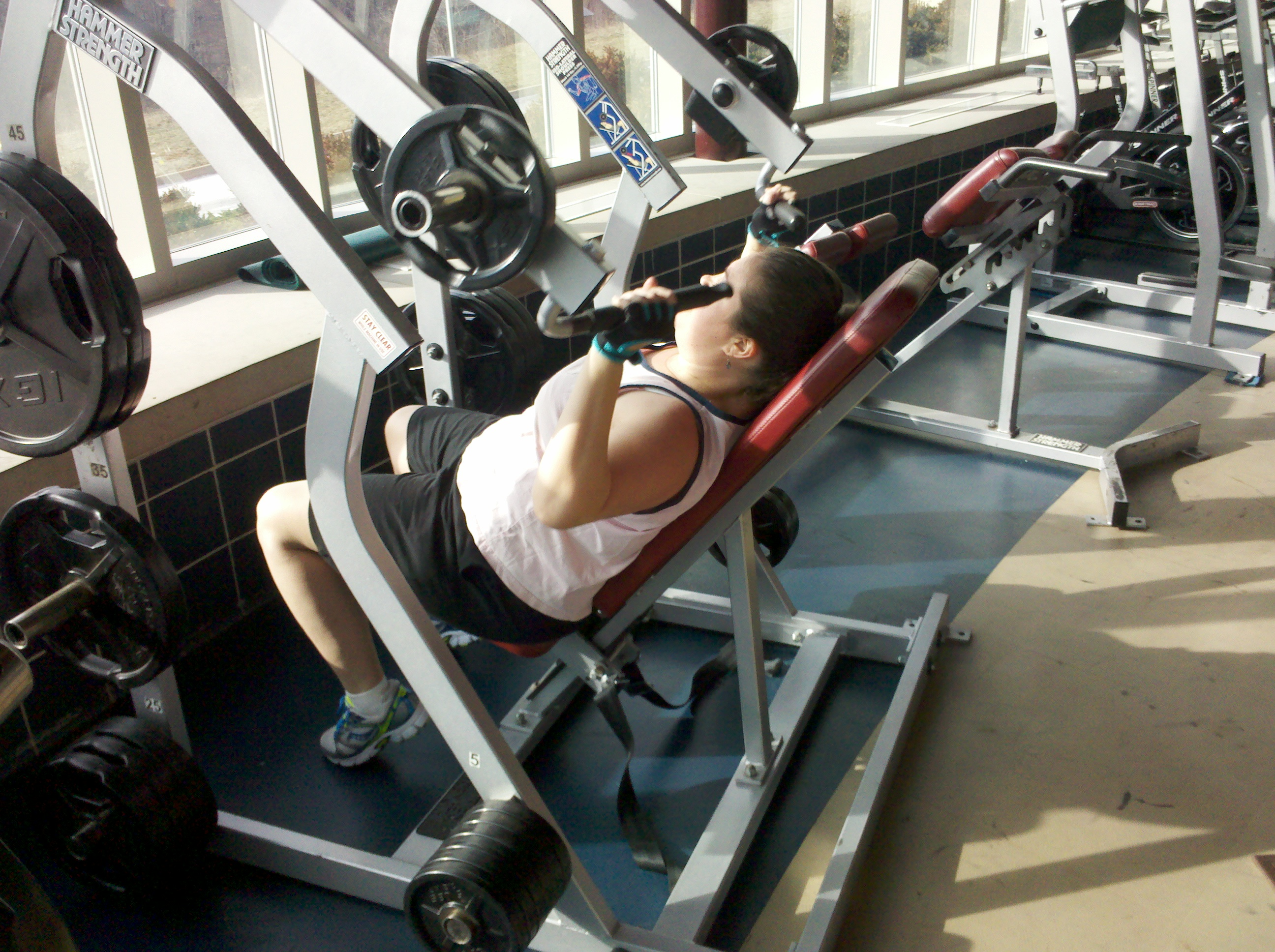 weight training gym personal trainer bench press goal